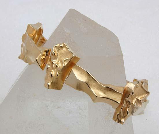 """Armbånd i gult gull, modell """"Undula variation""""."""