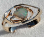 Forged bracelet in yellow gold with solid opal and diamonds.