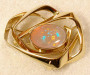 Brooch / lock in yellow gold with solid opal.