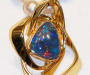 Forged brooch / pendant in yellow gold with free form opal triplet used as a pearl heng.