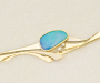 Brooch in yellow and white gold with boulder opal and diamonds.