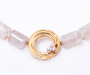 `Binde` Lock in yellow gold with 3 diamonds on a Rutilated Quartz Necklace