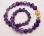 "Two locks - large and small in yellow gold, model: ""Physalis"" with necklace in faceted amethyst."
