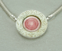 Pendant / lock in sterling silver with rhodocrosite. Necklace in sterling silver.