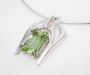 Pendant in white gold with green beryl.