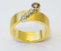 Ring in yellow gold with four diamonds.