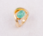 Ring in yellow gold with a Paraiba Tourmaline cabochon and Diamond