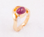 Ring in yellow gold with a pink Tourmaline cabochon and diamond