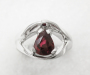 Ring forged in white gold with a drop faceted ruby.