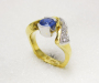 Ring in yellow and white gold with blue sapphire and diamonds.