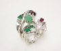Ring forged in white gold with diamond, emeralds and rubies.