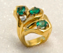 Ring in yellow gold with 3 emeralds and 1 diamond.