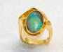 Ring in yellow gold with Australian boulder opal.