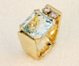Ring in yellow gold with rectangle Aquamarine and two diamonds.