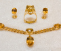 Jewellery set in yellow gold with citrine quartz, ring, earrings and necklace with pendant.