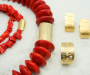"""Jewellery set in yellow gold, model: """"Tønne"""" Small lock with coral necklace, large lock with swamp coral necklace, ring with diamonds and matching earrings."""