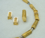 "Jewellery set in yellow and white gold, model: ""Rodo"" Necklace, ring and earrings."