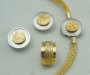 """Jewellery set in white and yellow gold """"Krymp"""" Lock with necklace knitted in yellow gold. Earrings and ring with diamonds."""