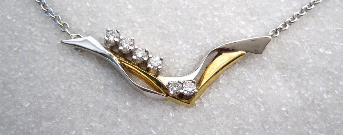 Lås i gult og hvitt gull med diamanter